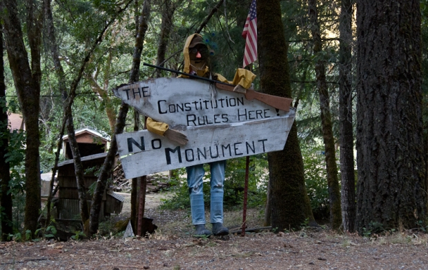 "One of the many ""NO MONUMENT"" signs dotting the road into Happy Camp."