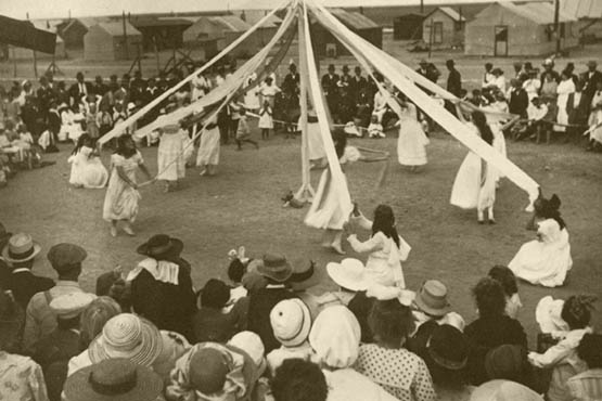 Colonists play Ring around the May Pole, an annual May Day tradition.