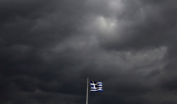 A Greek flag flutters atop the Acropolis hill in Athens February 18, 2015. Greece will request an extension of its loan agreement from its euro zone partners on Thursday morning, a Greek government official said on Wednesday. REUTERS/Yannis Behrakis (GREECE - Tags: POLITICS BUSINESS)